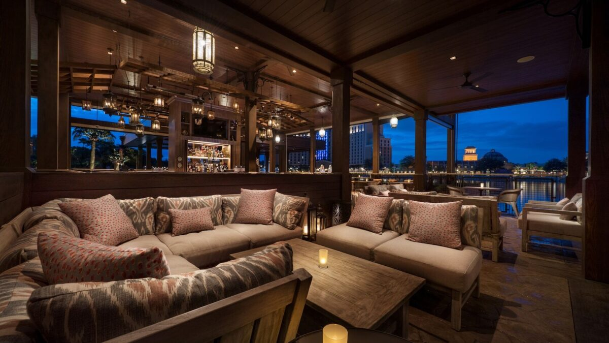 Lounge with couches and bar at night