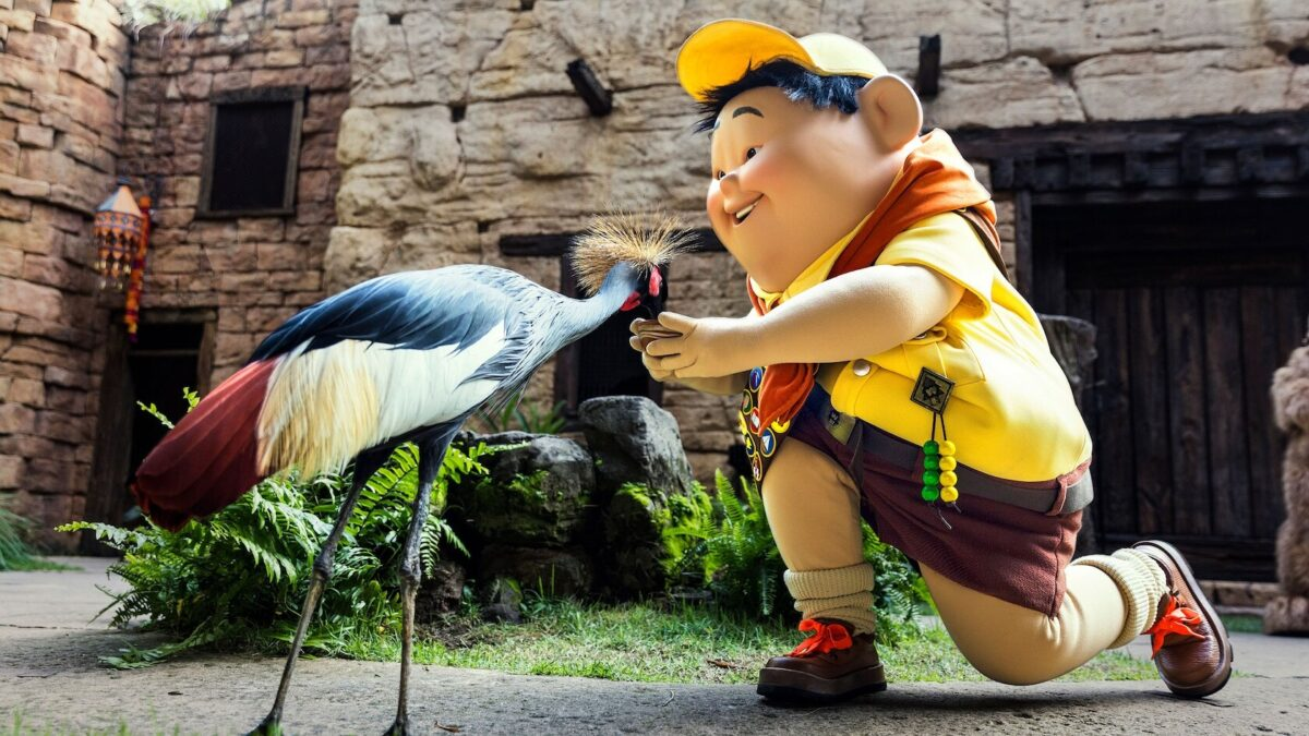Disney character feeding a live bird