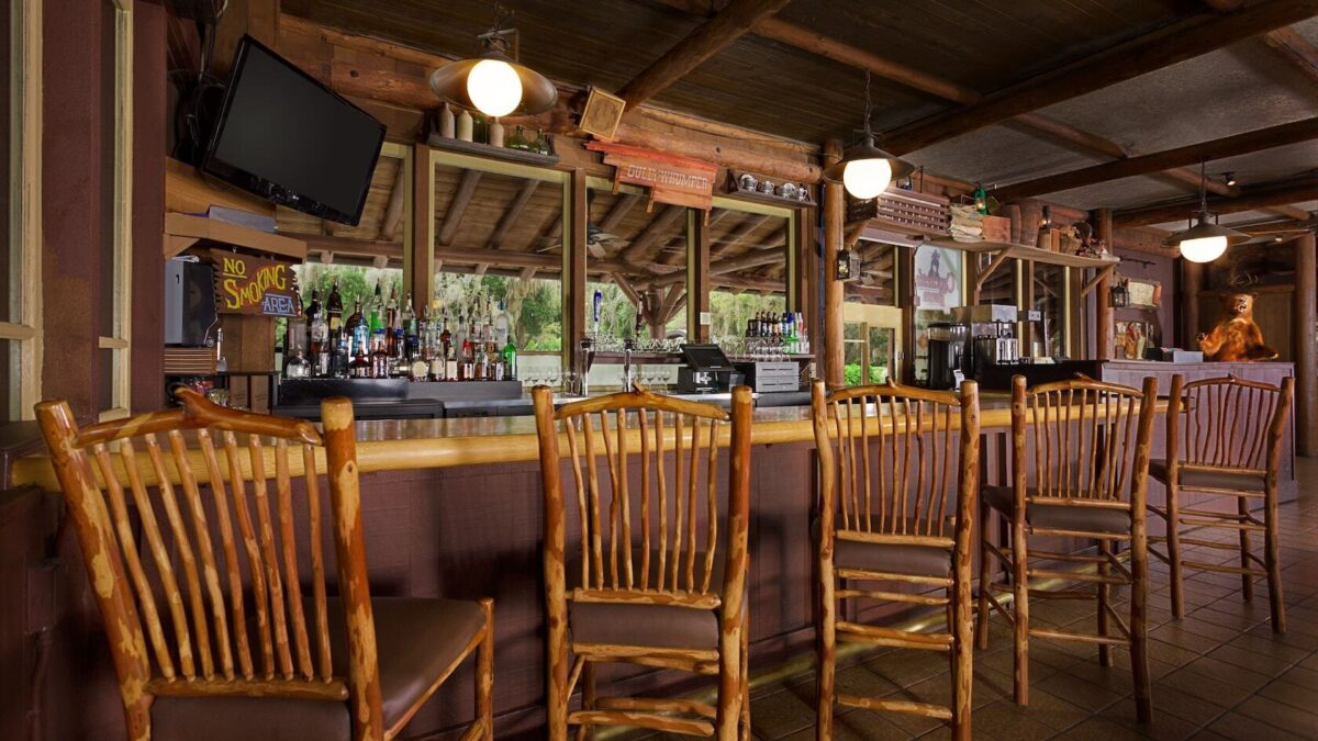 Bar with wood chairs and tv