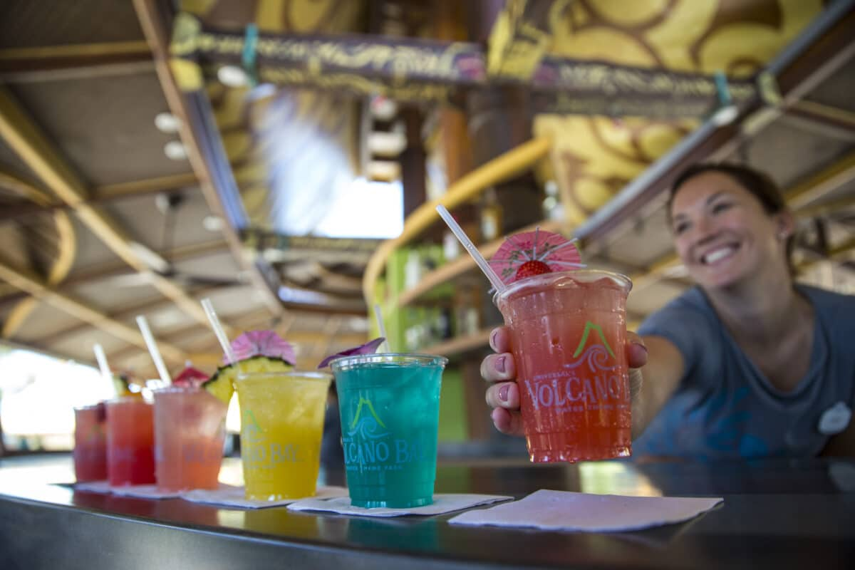Drinks in all colors being served at bar