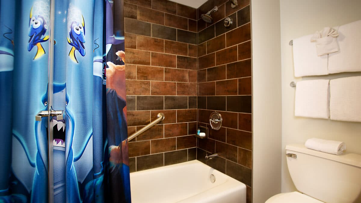 Bath with brick wall tile and curtain