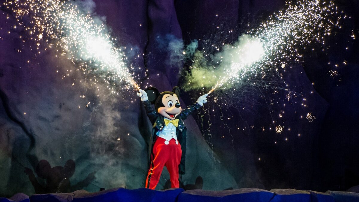 Mickey with fireworks at night