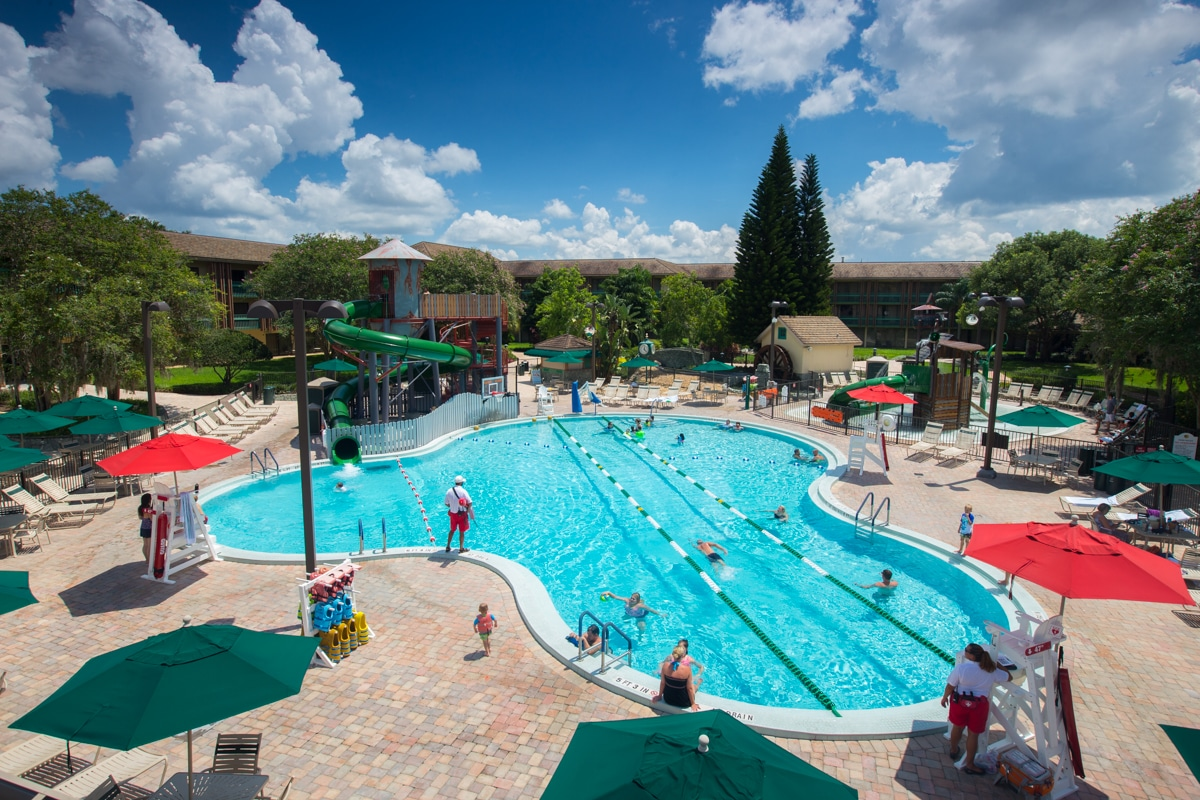 Outdoor pool with people swimming