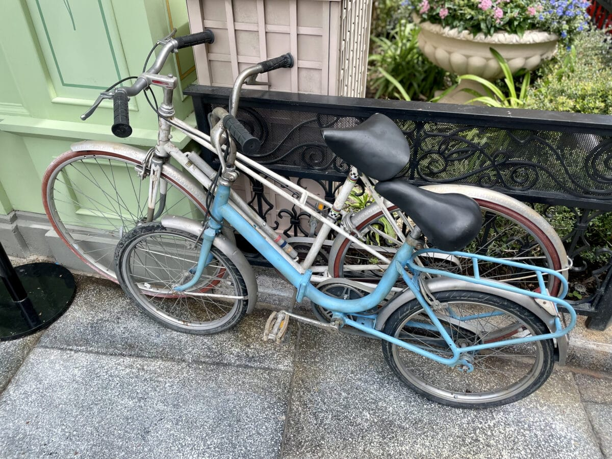 Two bikes parked on the street