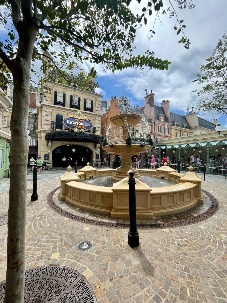 French street with fountain and lightpoles