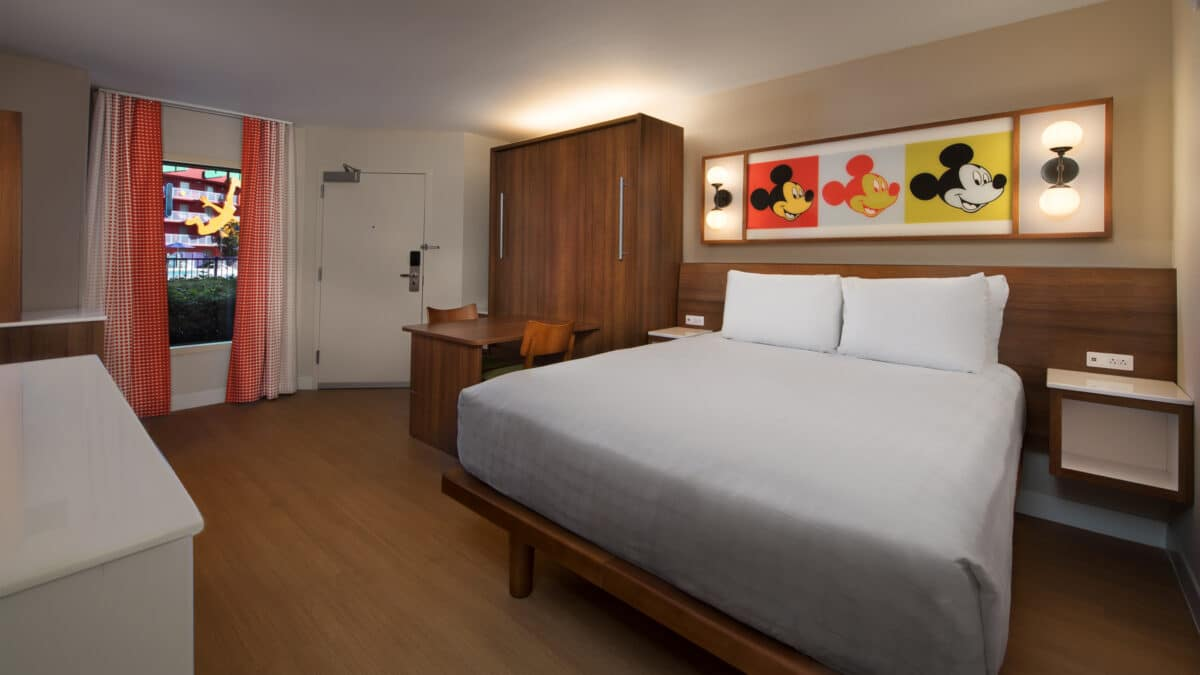 Hotel bedroom with made-up bed and cabinents